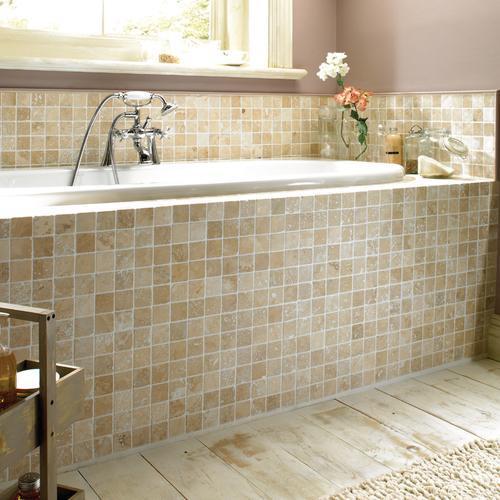 Travertine mosaics on a bathtub natural stone for Tumbled marble bathroom designs